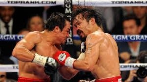 Juan Marquez has a fast, hard and accurate uppercut which he is seen landing here on Manny Pacquiao.