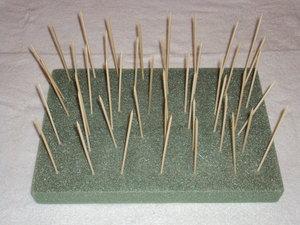 Punji sticks on a board.