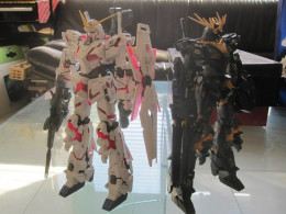 In this case, the models here are of the suits RX-0 Unicorn Gundam and the RX-0 Unicorn Gundam 02 Banshee.