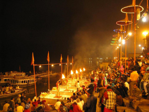 The Evening 'Aarti' Prayers In The River Ganges At Varanasi.