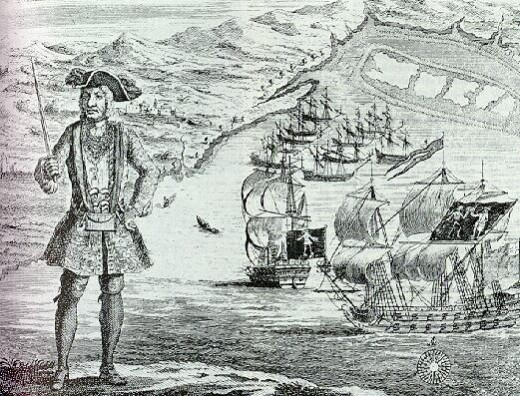 Bartholomew Roberts at Ouidah with his ship and captured merchantmen in the background