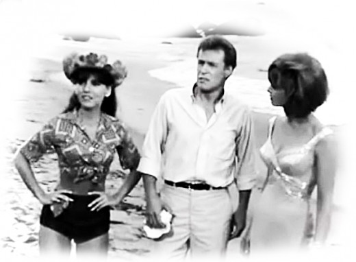 Dawn Wells as Mary Ann, Russell Johnson as Professor Roy Hinkley and Tina Louise as Ginger Grant