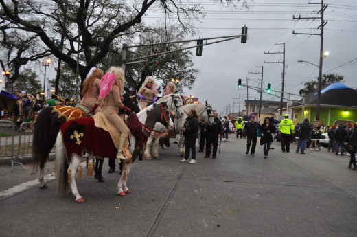 The Lady Godivas ride between the floats