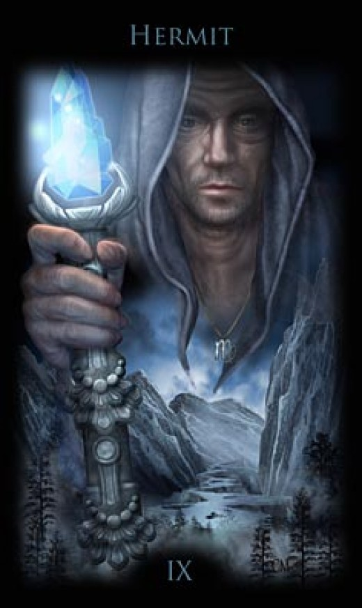 "This ""Hermit"" Tarot card depicts a magical staff instead of a lantern. Although he resembles a magician, the mountains at the bottom of the card signify the Hermit's jouney."