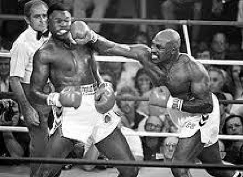 Earnie Shavers, seen here smacking Larry Holmes, is considered one of the heaviest punchers ever.