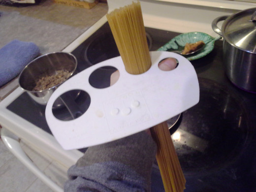 Step Five: Measure out the right amount of spaghetti noodles. I measured for two people.