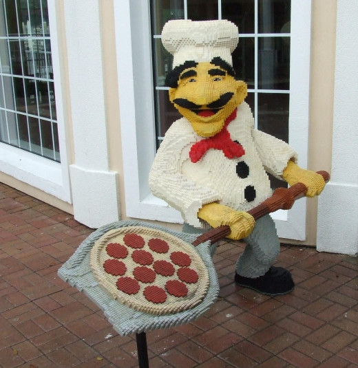 A chef statue at the entrance of a restaurant.