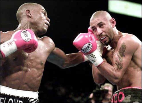 Floyd Mayweather unified the jr. lightweight championship by knocking out the then undefeated Diego Corrales.