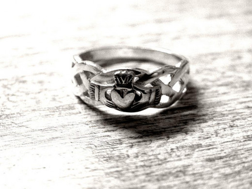 A Claddagh Ring with Celtic Twist and Hands