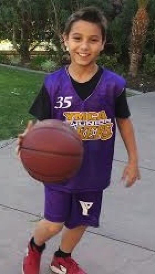 My son Ari ready for his first Jr. Lakers game at the YMCA.