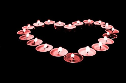 Candle display of hearts.