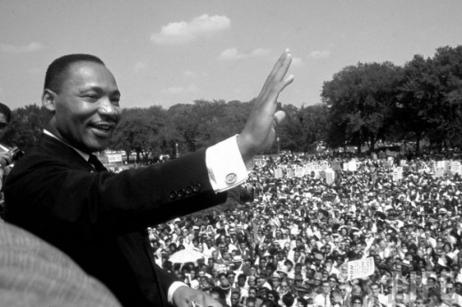 "Martin Luther King, Jr. waves to supporters before he delivers the ""I Have a Dream"" speech on August 28, 1963, in Washington, D.C."