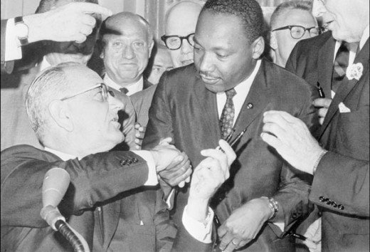 Dr. King shakes hand with President of the United States Lyndon Johnson at the signing of the Civil Rights Act.