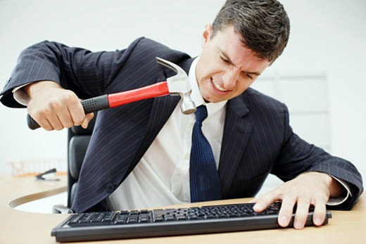 Surveys reveal stress is causing office workers to erupt in outbursts of 'desk rage'.