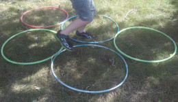 An obstacle course event can include running through rings, aka hula hoops.