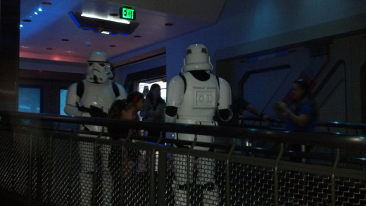 Stormtroopers looking for Rebel Spies in the line for Star Tours- The Adventures Continue.