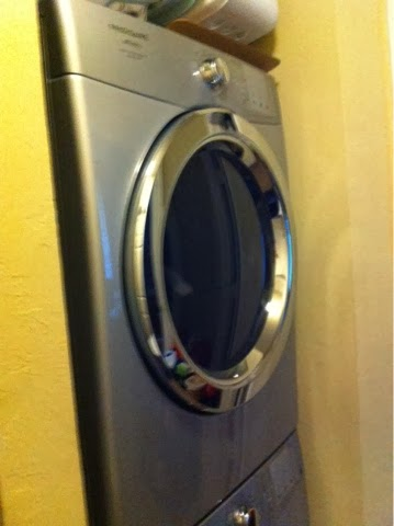Be creative! Make little knobs or switches out of foil or paint. Check out your washer or dryer for more inspiration!