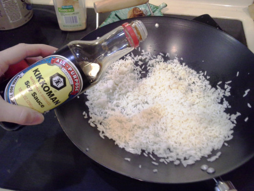 Step Seven: Now add your soy sauce to your rice