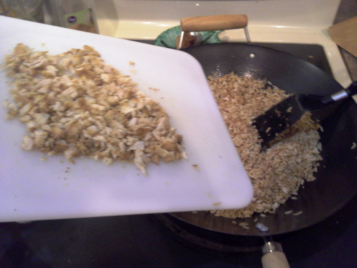 Step Thirty: I finely chopped some previously cooked chicken from another recipe and added it to my cooked rice in the Wok