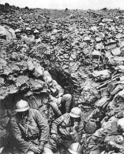 A typical image from World War One, showing French troops stationed in an extremely muddy trench.