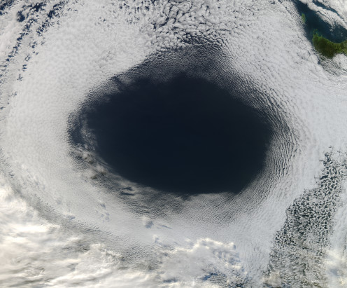 This Anticyclone, photographed by a NASA satellite over Australia, is spinning counterclockwise as it is the southern hemisphere.  Anticyclones in the northern hemisphere spin clockwise due to the Coriolis Effect.