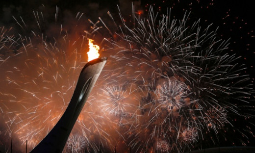 Olympic torch and fireworks display. Opening Ceremony of Sochi Winter Olympics 2014