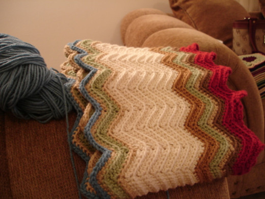 This ripple afghan is crocheted in a single piece without joining. The color changes will mean weaving in ends, however.