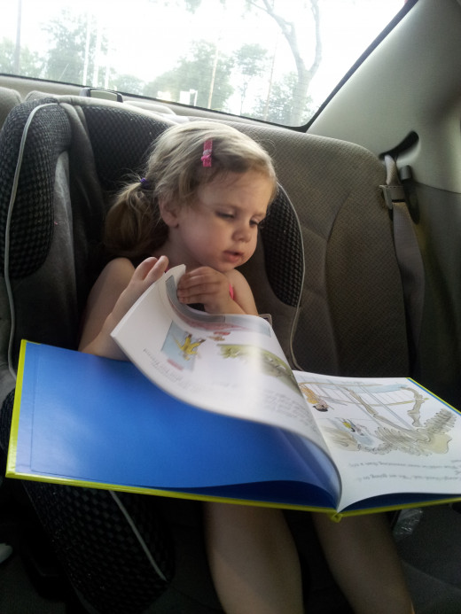 My Daughter Reading in the Car