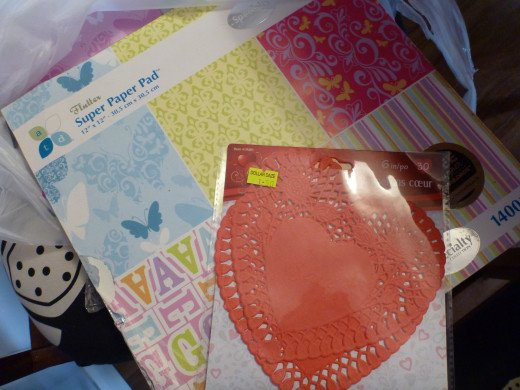 Red heart lace doilies and scrapbook paper