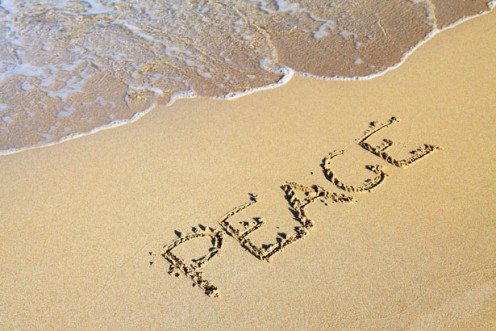 Image of the word Peace on the beach.