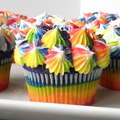 Rainbow Swirl Icing dabbed on top of cupcakes