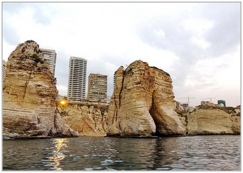 Corniche is shot through two Pigeon rocks. Shot is made from the boat