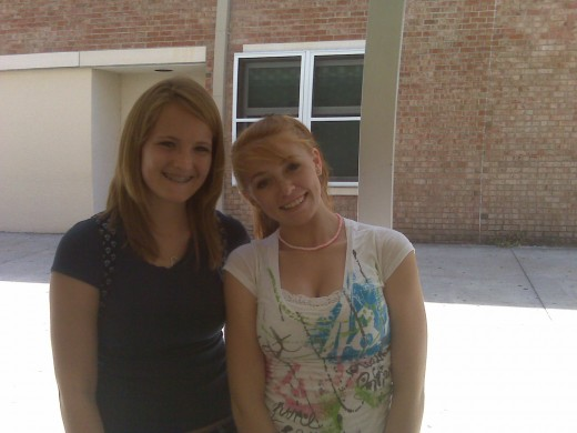 Two cheerleader friends (outside of their uniforms) in the corridors of Port Charlotte High School.