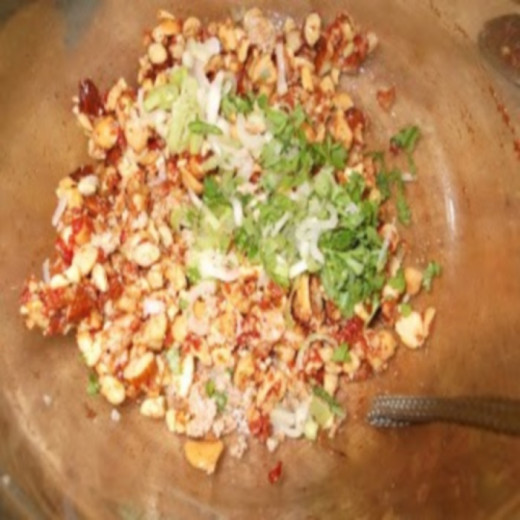 Mix the chopped nuts with the tomato puree and remaining ingredients, adding more tomato puree if you find they are not binding.
