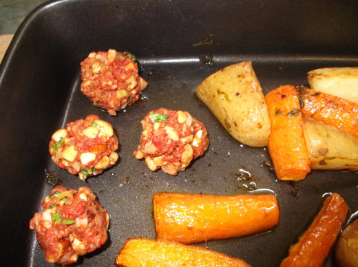 Add the nut balls to the roasting pan with the vegetables