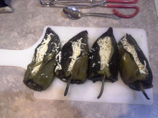 Step Twenty-two: Try your best to fold over your chiles to seal the cheese in