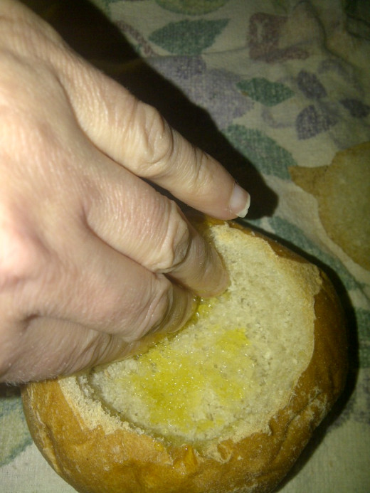 Liberally apply olive oil to all inside areas of the bun!  Don't leave any area left dry.