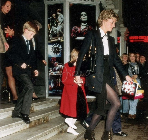 Princess Diana and Prince Harry leave the theatre after a performance of 'Oliver'. - December 1994