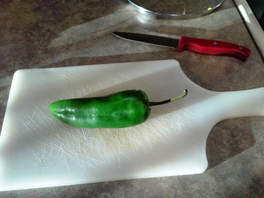 Step Five: Pull out an Anaheim pepper and prepare a cutting board and knife