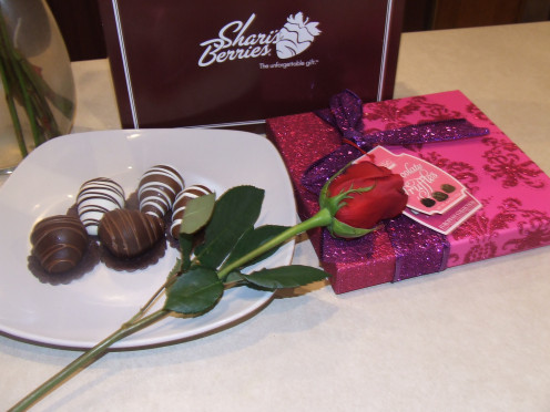Chocolates on plate with a rose with Sherrie Berries.