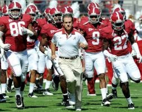 Coach Nick Saban leads the National Champion Alabama Crimson Tide onto the football field.