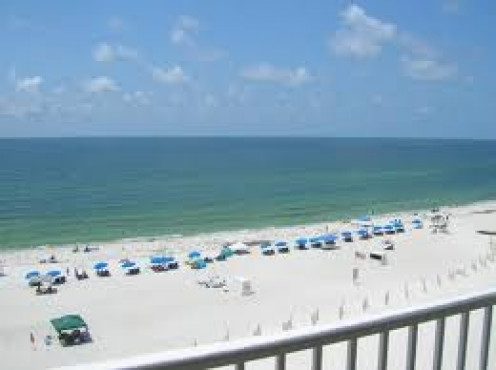 Gulf Shores, Alabama is a humongous beach and ocean that stretches to Florida.