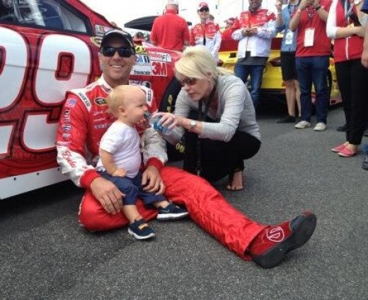 Harvick (with his family before the race) picked up the win at Kansas last year, where an experimental tire made the race a crapshoot