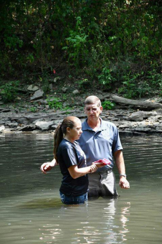 Baptizing my daughter in the river