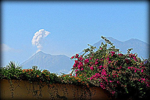Volcan Fuego erupts in the distance