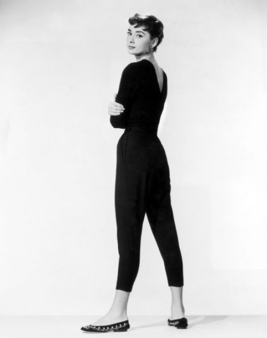 Audrey in cropped black pants, a slim black sweater, and cute ballet flats!