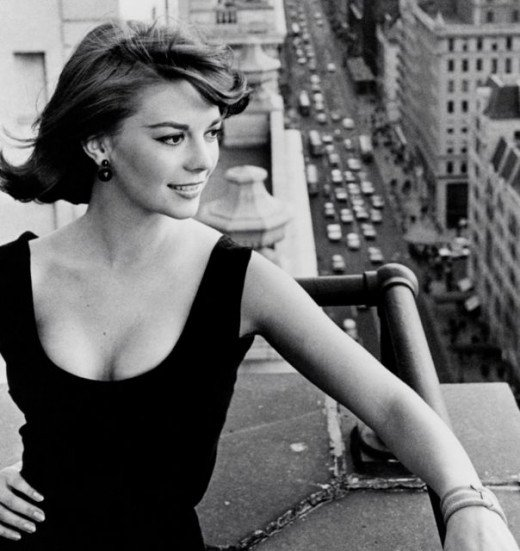 Lovely Natalie Wood shows off her shoulders in a sleek scoop neck and studs.