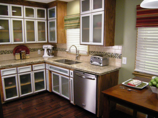 This newly  remodeled kitchen highlights the clean linear lines an undermount sink can provide.