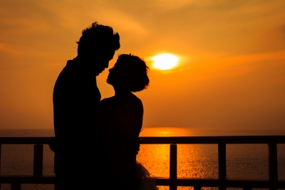 """Couple Silhouette On The Beach At Sunset"" by pat138241"