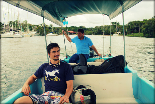 Andy and lancha captain on the Rio Dulce